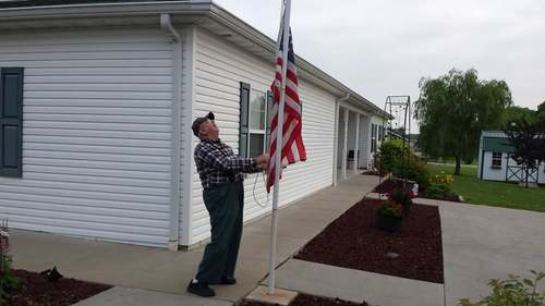 Raising The Flag at R & R Country Care Senior Living